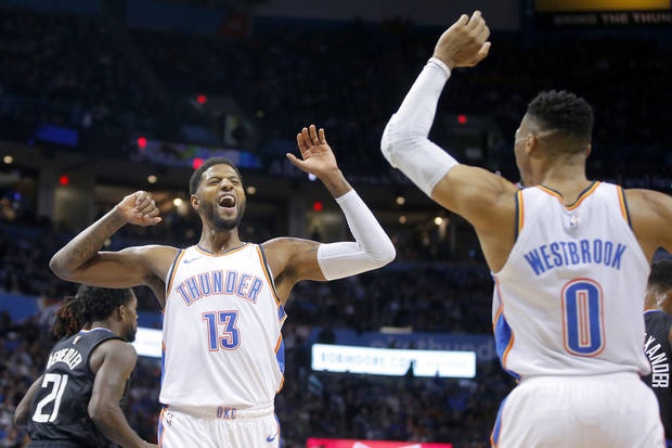 Oklahoma City Thunder's Paul George (13) celebrates with Russell Westbrook (0) during an NBA basketball game between the Oklahoma City Thunder and the Los Angeles Clippers at Chesapeake Energy Arena in Oklahoma City, Saturday, Dec. 15, 2018. Photo by Bryan Terry, The Oklahoman