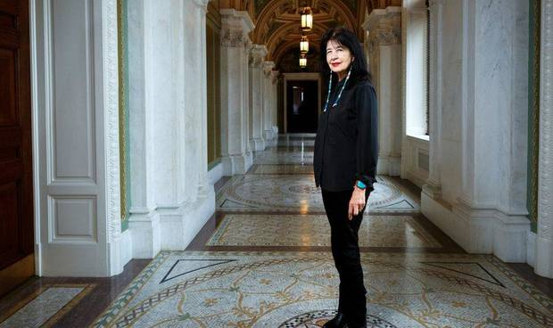 In this June 6, 2019, photo, Joy Harjo, of the United States, poses inside the Library of Congress, in Washington. Harjo is the U.S. poet laureate, becoming the first Native American and first Oklahoman to hold that position. [Shawn Miller/Library of Congress]