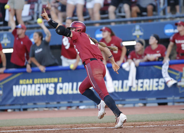Oklahoma's Sydney Romero (2) celebrates a home run in the 3rd inning during the second NCAA softball game in the championship series of the Women's College World Series between Oklahoma and UCLA at USA Softball Hall of Fame Stadium in Oklahoma City, Tuesday, June 4, 2019. [Sarah Phipps/The Oklahoman]