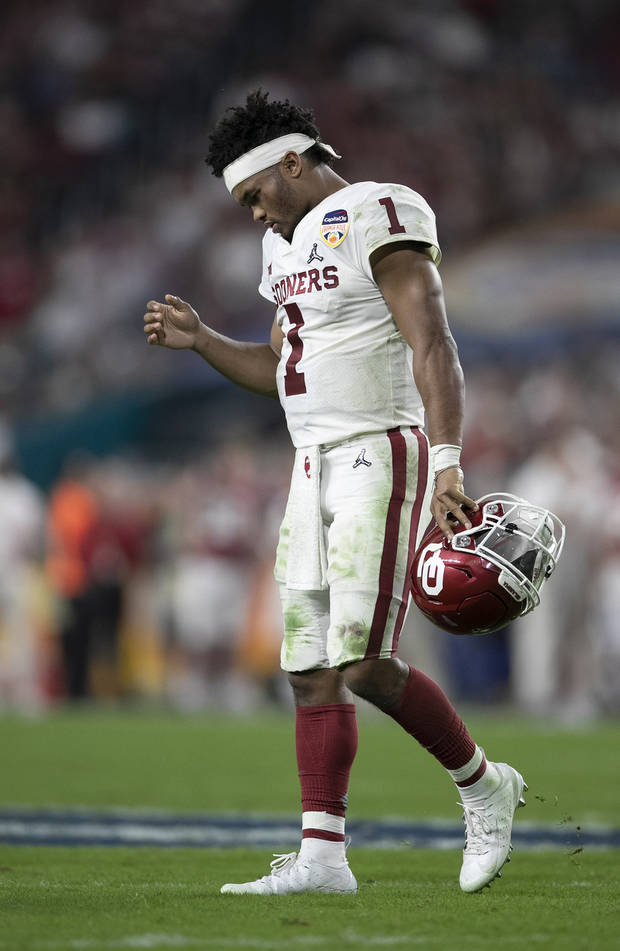02461612e71 Kyler Murray walks off the field during the Orange Bowl. (Photo by Allen  Eyestone