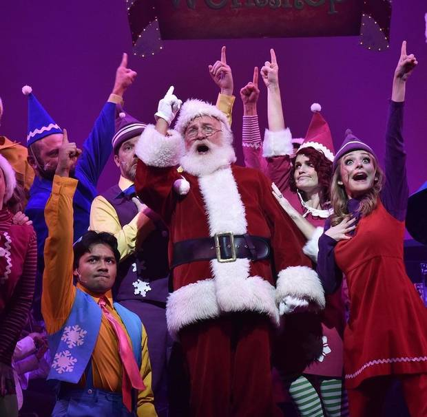 "Santa Claus (Stephen Hilton) and his elves (the members of the Philharmonic Pops Chorale) sing during the Oklahoma City Philharmonic's ""The Christmas Show."" [Wendy Mutz photo]"
