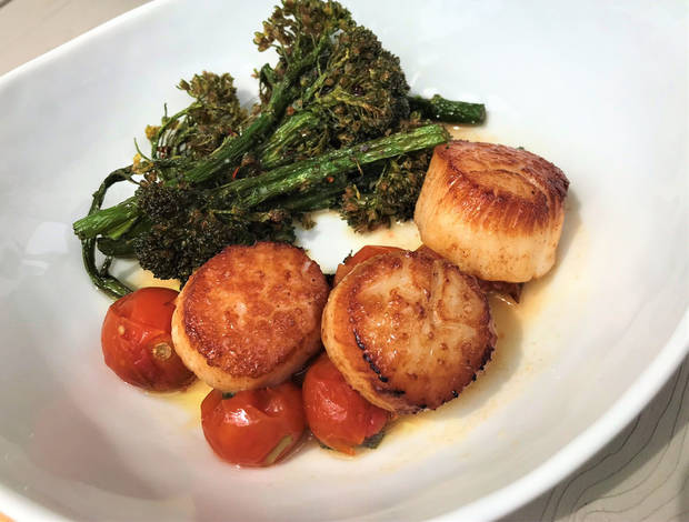 Seared Scallops and fried broccolini from Lua Mediterranean in The Plaza District. [Dave Cathey/The Oklahoman]