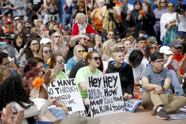 "A crowd moves south on Lincoln Blvd. toward the state Capitol during a ""March for Our Lives"" rally in support of gun control in Oklahoma City, Saturday, March 24, 2018. (Bryan Terry/The Oklahoman via AP)"