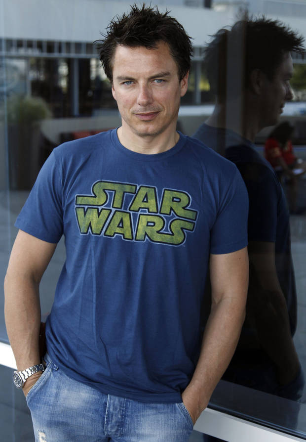 "Actor John Barrowman, from the Starz series ""Torchwood: Miracle Day"", poses for a portrait during Comic Con in San Diego, Saturday, July 23, 2011. (AP Photo/Matt Sayles)"