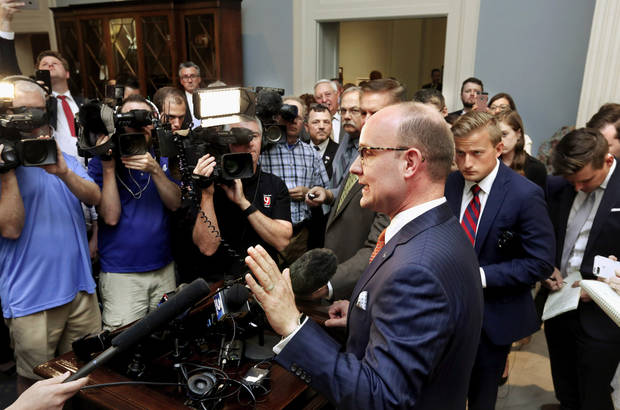 House minority leader Scott Inman is surrounded by reporters and cameras as he responds to the governor's most recent tax plan. Gov. Mary Fallin joined Republican leaders of the House and the Senate to announce a plan they say will help solve the state's budget crisis. They stood  before a standing room only crowd  in the state Capitol's Blue Room Tuesday afternoon, May 16, 2017.  In a last-ditch effort to fund government, Gov. Mary Fallin and Republican leadership outlined a revenue-generating plan  and challenged Democrats to support the $400 million tax increase legislation the minority has already vowed to oppose. Photo by Jim Beckel, The Oklahoman