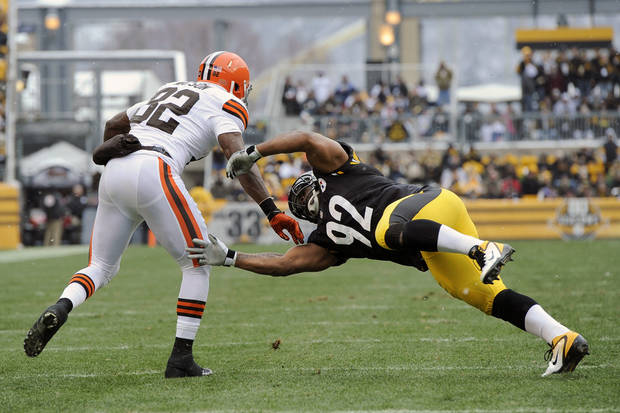 Cleveland Browns tight end Benjamin Watson (82) gets past Pittsburgh Steelers outside linebacker James Harrison (92) after maiking a catch in the first quarter of an NFL football game on Sunday, Dec. 30, 2012, in Pittsburgh. (AP Photo/Don Wright)