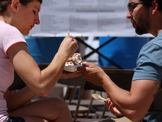 Helen and Kyle Williams share a brownie sundae during the 2018 Festival of the Arts in Bicentennial Park in downtown Oklahoma City, Saturday, April 28, 2018. [Photo by Doug Hoke/The Oklahoman Archives]