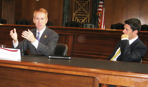 Then-Rep. James Lankford, left, speaks at a State Chamber visit to Washington in 2013, while Rep. Paul Ryan listens.