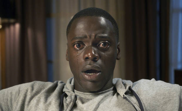 "This image released by Universal Pictures shows Daniel Kaluuya in a scene from, ""Get Out."" On Wednesday, Dec. 13, 2017, Kaluuya was nominated for a screen Actors Guild Award for male actor in a leading role in a motion picture. The SAG Awards will air live on Sunday, Jan. 21 on TNT and TBS. [Photo provided by Universal Pictures via AP]"
