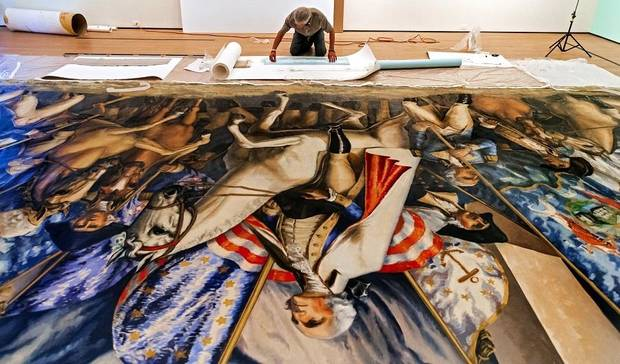 "Conservator Carmen Bria works on the Gardner Hale mural ""Triumph of Washington"" at the Oklahoma City Museum of Art in Oklahoma City, Okla. on Thursday, Aug. 15, 2019. The mural, which has not been exhibited publicly since the first president's bicentennial celebration in 1932, is the centerpiece of the exhibit ""Renewing the American Spirit"" at the museum. [Chris Landsberger/The Oklahoman Archives]"