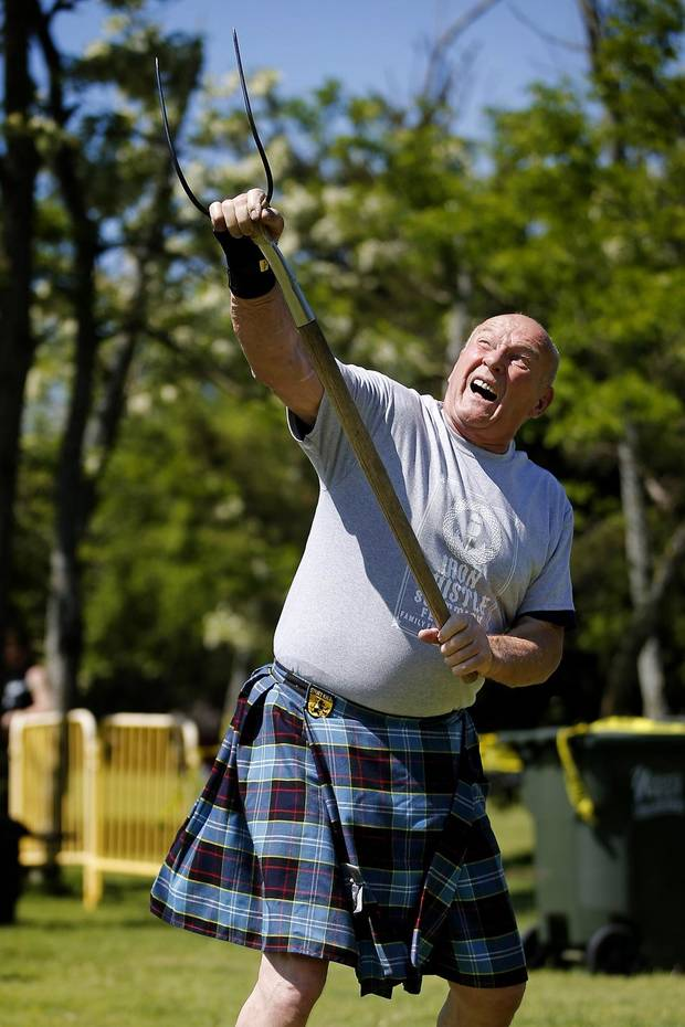 Dean Ross of Tulsa competes in the sheaf toss during during the Iron Thistle Scottish Festival in Yukon, Okla., Saturday, April 27, 2019. [Bryan Terry/The Oklahoman Archives]