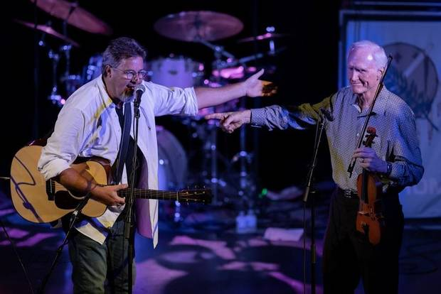 "From left, Vince Gill and Byron Berline appear on stage Tuesday night at ""The Music Never Dies"" benefit concert on behalf of Berline at Guthrie's historic Scottish Rite Temple. [Photo provided by Tom Dunning]"