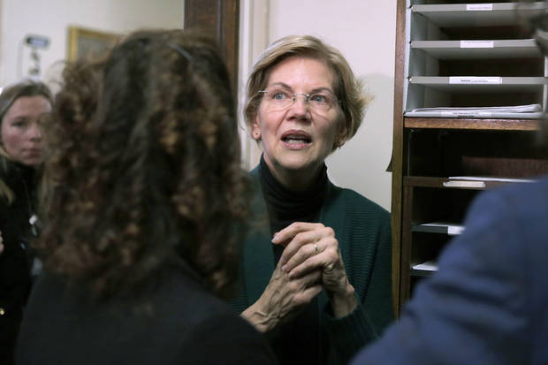 Warren files for NH primary, scorns 'billionaires'