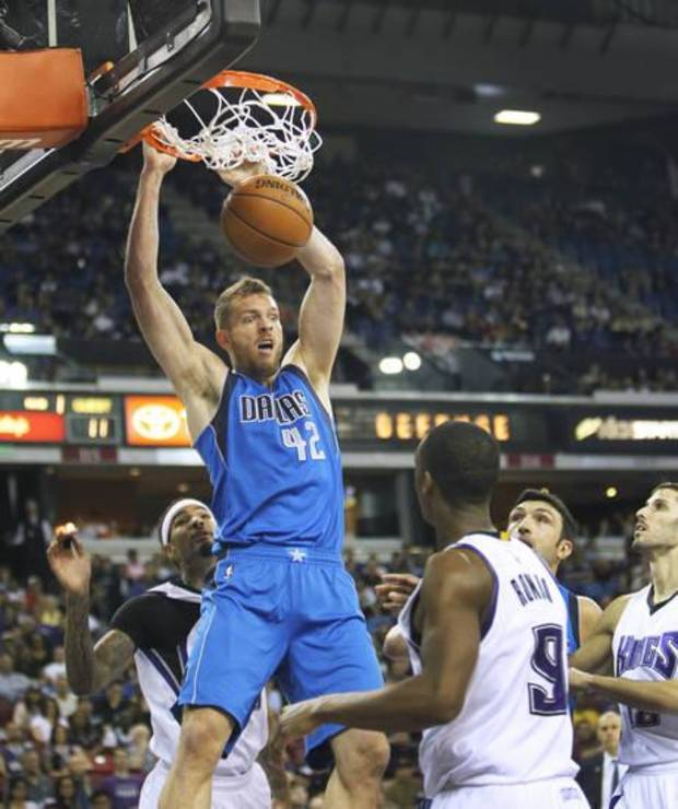 Dallas Mavericks forward David Lee (42) breaks away for a dunk against the Sacramento Kings during the first half of an NBA basketball game in Sacramento, Calif., Sunday, March. 27, 2016.(AP Photo/Steve Yeater) | Imported: Sun. Mar 27, 2016 at 8:09pm Photographer: Steve Yeater