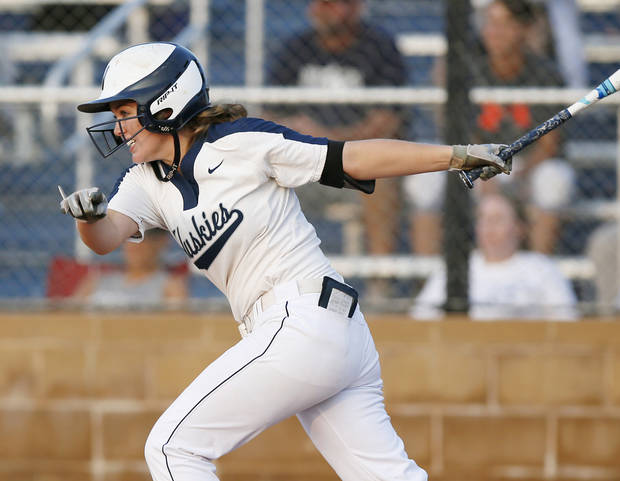 Edmond North's Jacee Minter (22) hits an RBI single in the fifth inning during a high school softball game between Edmond North and Deer Creek at Deer Creek High School in Edmond, Okla., Monday, Aug. 20, 2018. Photo by Nate Billings, The Oklahoman