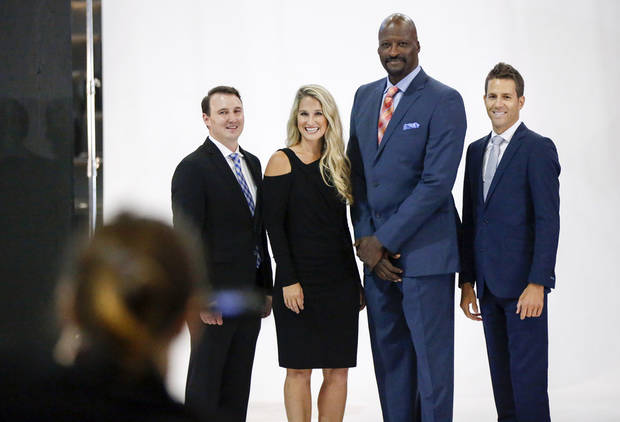 From left, Thunder television broadcasters Nick Gallo, Lesley McCaslin, Michael Cage and Chris Fisher, take a group photo during media day for the Oklahoma City Thunder at Chesapeake Energy Arena in Oklahoma City, Monday, Sept. 24, 2018. Fisher is the new television play-by-play announcer for the Thunder. Photo by Nate Billings, The Oklahoman