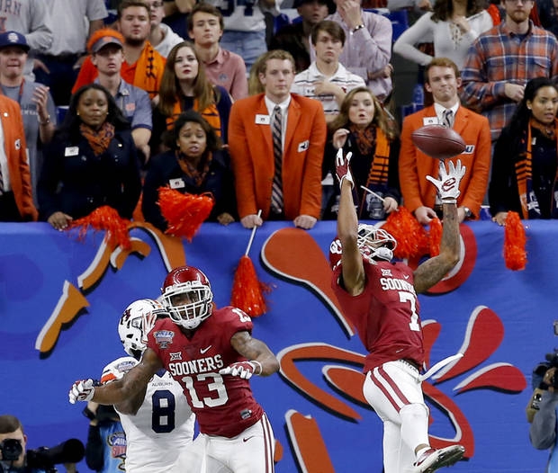 Jordan Thomas intercepts a pass against Auburn in the Sugar Bowl. (Photo by Bryan Terry)