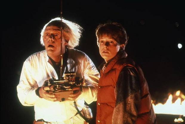 "Christopher Lloyd and Michael J. Fox appear in ""Back to the Future."" [MCA/Universal Pictures photo]"