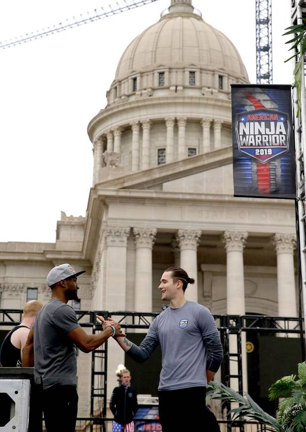 "Testers prepare to run an obstacle course on the set of NBC's ""American Ninja Warrior"" at the state Capitol in Oklahoma City, Friday, April 12, 2019. [Photo by Sarah Phipps/The Oklahoman Archives]"