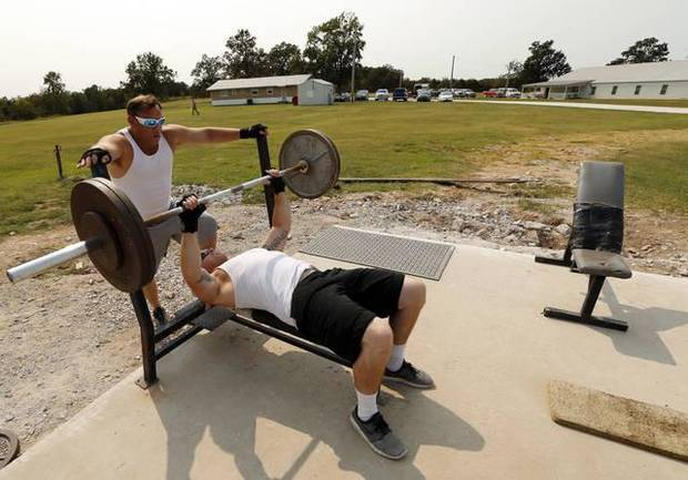 Kevin Ledgerwood and Chance Hover, right, work out with weights at the Christian Alcoholics & Addicts in Recovery (CAAIR) rehab center in Jay. [Photo by Steve Sisney, The Oklahoman]
