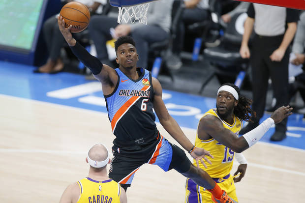 Oklahoma City's Hamidou Diallo (6) goes past Los Angeles' Montrezl Harrell (15) to score during an NBA basketball game between the Oklahoma City Thunder and the Los Angeles Lakers at Chesapeake Energy Arena in Oklahoma City, Wednesday, Jan. 13, 2021. San Antonio won 112-102. [Bryan Terry/The Oklahoman]