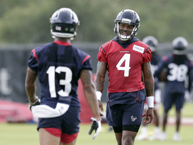 Houston Texans quarterback Deshaun Watson (4) talks with Tyron Johnson (13) during a NFL football Organized Team Activity workout Tuesday, May 21, 2019, at the team practice facilities in Houston. (AP Photo/Michael Wyke)