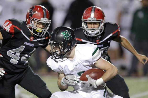 Norman North's Drake Stoops runs for extra yardage after a reception during the first half of their 6A-I semifinal with Mustang in Yukon, Friday November, 18 2016. Photo By Steve Gooch, The Oklahoman