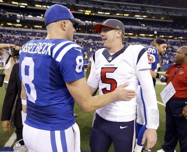 Colt quarterback Matt Hasselbeck talks with Brandon Weeden following the Texans' 16-10 victory Sunday. (AP Photo)