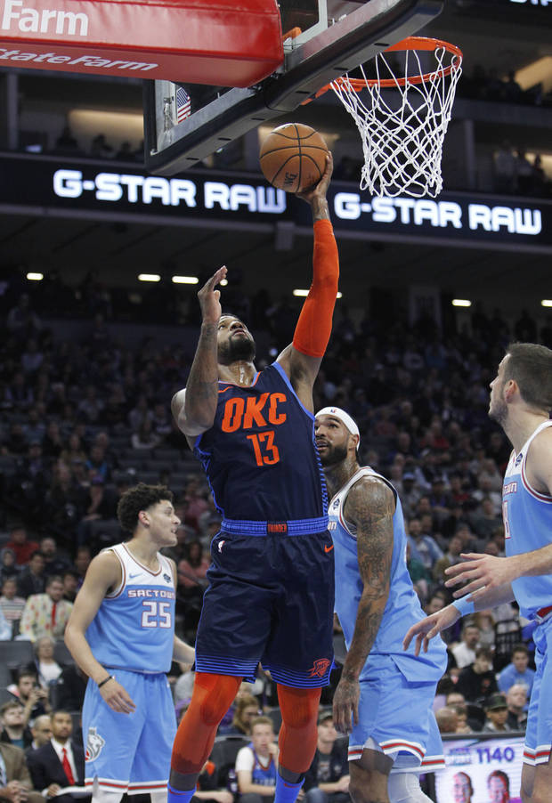 Oklahoma City Thunder forward Paul George (13) breaks away for a basket against the Sacramento Kings during the first half of an NBA basketball game in Sacramento, Calif., Wednesday, Dec. 19, 2018. (AP Photo/Steve Yeater)