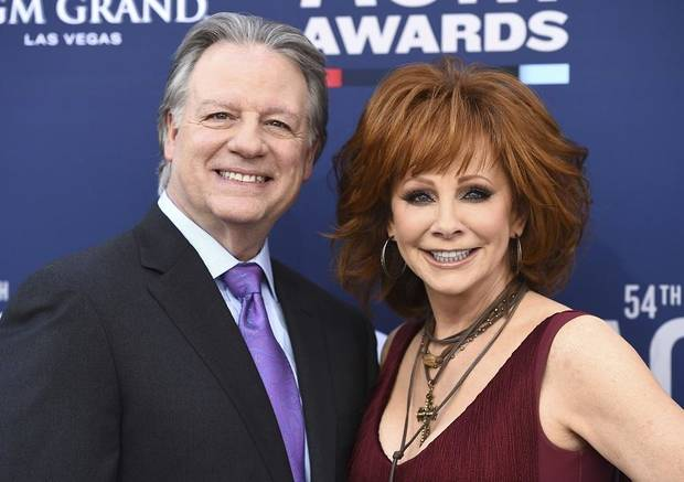 Anthony Lasuzzo, left, and Reba McEntire arrive at the 54th annual Academy of Country Music Awards at the MGM Grand Garden Arena on Sunday, April 7, 2019, in Las Vegas. (Photo by Jordan Strauss/Invision/AP)
