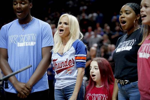 Kristin Chenoweth, center, sings the national anthem with students from her Broadway Boot Camp before the NBA game between the Oklahoma City Thunder and the L.A. Clippers at the Chesapeake Energy Arena, Tuesday, Oct. 30, 2018. OSU won 38-35. [Photo by Sarah Phipps, The Oklahoman Archives]