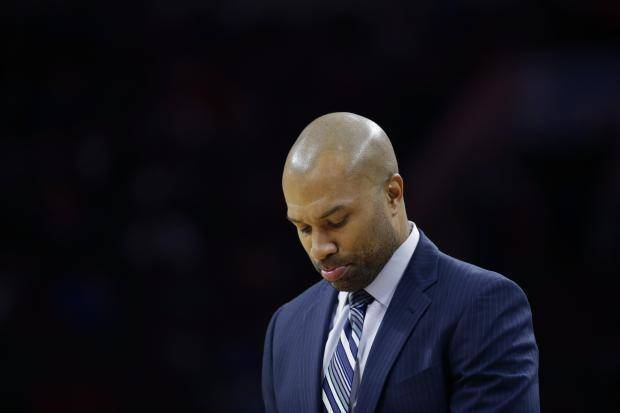Derek Fisher stands on the sideline during an NBA basketball game against the Philadelphia 76ers, in Philadelphia. Fisher was fired as New York Knicks coach Monday, Feb. 8, 2016, with his team having lost five straight and nine of 10 to fall well back in the Eastern Conference playoff race. (AP Photo/Matt Slocum, File)