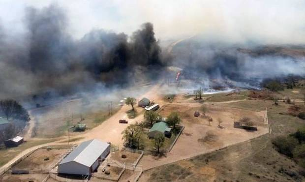 The Anderson Creek fire in Woods County is shown Wednesday. Hundreds of firefighters were battling a wildfire Thursday that spread from Oklahoma to Kansas and has burned more than 625 square miles. [Photo provided by the Oklahoma Forestry Services via AP]