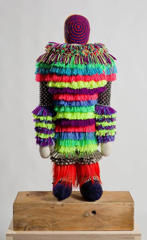 "The beaded figures in Jeffrey Gibson's solo exhibition ""Speak to Me,"" like ""The Clown,"" were inspired by Gibson's memories of Native American dolls at Chicago's Field Museum. He also notes the influence of kachina dolls of the Southwest Hopi Indians, and the army of warriors modeled in terra-cotta from ancient China. Photo provided"