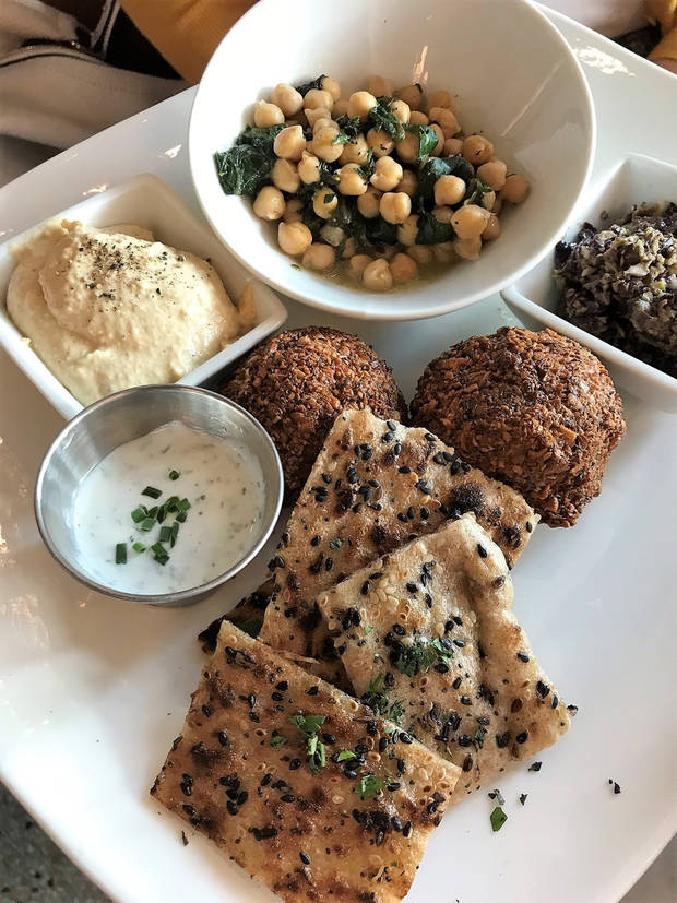 Falafel is served with hummus, tapenade, chickpeas, tzatziki and flatbread. [Dave Cathey/The Oklahoman]