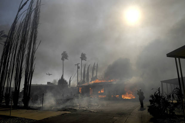 Son says mother, 89, missing after California homes burn