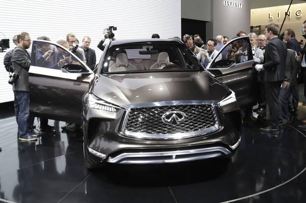 Journalists take a closer look at the Infiniti QX 50 concept unveiled at the North American International Auto show, Monday, Jan. 9, 2017, in Detroit. (AP Photo/Carlos Osorio)