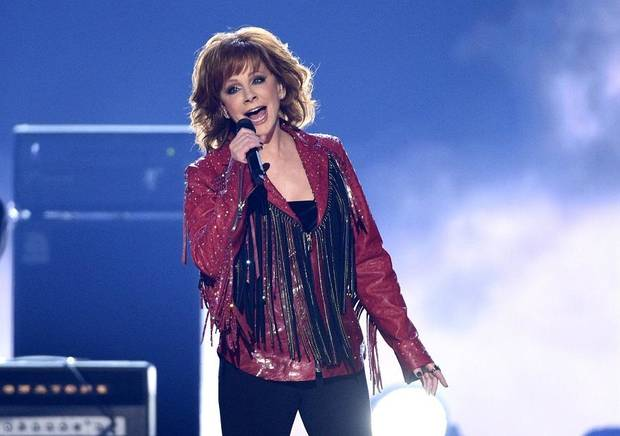 "Reba McEntire performs ""Freedom"" at the 54th annual Academy of Country Music Awards at the MGM Grand Garden Arena on Sunday, April 7, 2019, in Las Vegas. (Photo by Chris Pizzello/Invision/AP)"