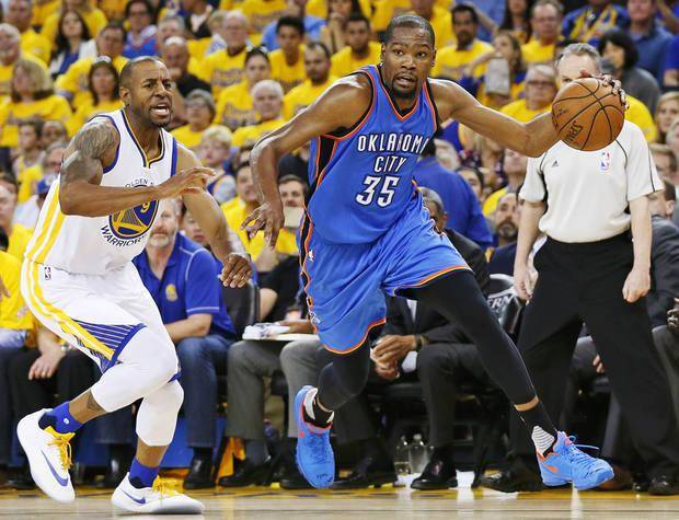 Oklahoma City's Kevin Durant (35) drives past Golden State's Andre Iguodala (9) during Game 2 of the Western Conference finals in the NBA playoffs between the Oklahoma City Thunder and the Golden State Warriors at Oracle Arena in Oakland, Calif., Wednesday, May 18, 2016. Photo by Nate Billings, The Oklahoman