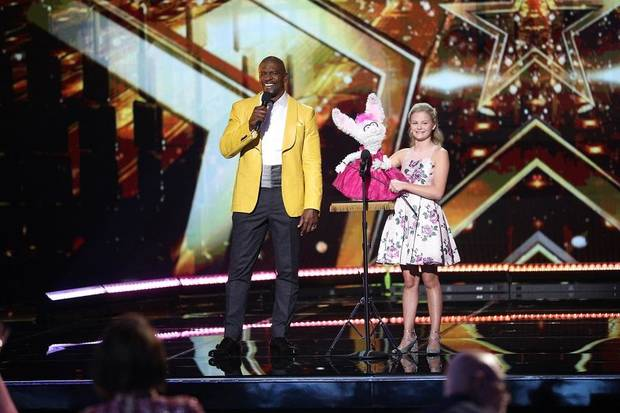 "Host Terry Crews, left, and Darci Lynne Farmer appear on the ""America's Got Talent: The Champions"" finals episode that aired tonight. Photo byJordin Althaus/NBC"
