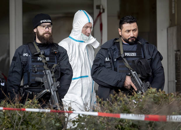 German gunman calling for genocide kills 9 people