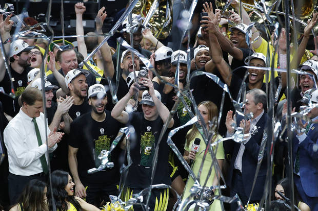 Oregon's basketball team celebrates after beating Washington 68-48 in  the Pac-12 title game Saturday night. (AP Photo)