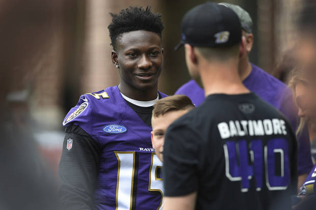 Baltimore Ravens rookie wide receiver Marquise Brown, left, greets fans after an NFL Football rookie camp, Saturday, May 4, 2019 in Owings Mills, Md. (AP Photo/Gail Burton)