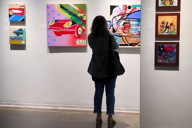 A viewer takes a photo of art by Steven Bayliss on display during the social-media preview of ArtNow 2019 at Oklahoma Contemporary in Oklahoma City. [Photo by Chris Landsberger, The Oklahoman]