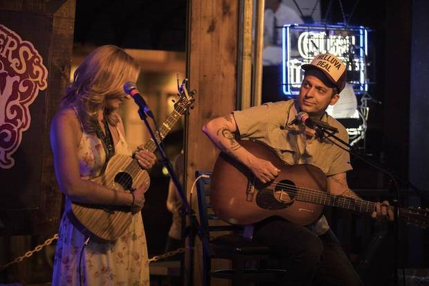 Wink Burcham, right, and Kim Reynolds perform n Stillwater during the 2018 Bob Childers' Gypsy Cafe songwriters festival. [Photo by Nathan Poppe]