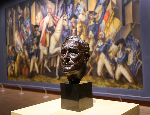 "Jo Davidson's bronze bronze bust of Franklin D. Roosevelt is displayed in front of Gardner Hale's oil on canvas mural ""Triumph of Washington"" in the Oklahoma City Museum of Art exhibit ""Renewing the American Spirit: the Art of the Great Depression"" Wednesday, October 30, 2019. [Doug Hoke/The Oklahoman]"