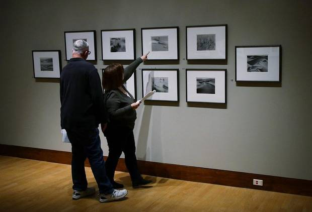 "A couple looks at a display of Brett Weston photographs at the Oklahoma City Museum of Art exhibit ""Ansel Adams and the Photographers of the West"" Friday, February 1, 2019. [Photo by Doug Hoke, The Oklahoman]"