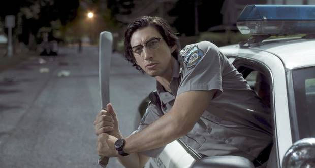 "Adam Driver stars as Officer Ronald Peterson in a scene from ""The Dead Don't Die."" [Focus Features photo]"