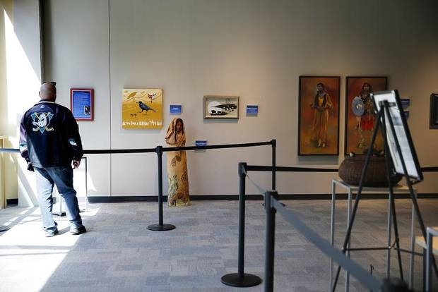 "A visitor walks through the exhibit ""She Persisted,"" presented by Red Earth Art Center, inside Science Museum Oklahoma in Oklahoma City, Thursday, March 21, 2019. [Photo by Bryan Terry/The Oklahoman]"