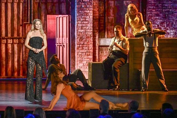 "Kelli O'Hara, left, and the cast of ""Kiss Me, Kate"" perform at the 73rd annual Tony Awards at Radio City Music Hall on Sunday, June 9, 2019, in New York. [Photo by Charles Sykes/Invision/AP]"